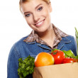 Woman holding a bag full of healthy food. shopping . — Stock Photo #19448293