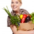 Woman holding a bag full of healthy food. shopping . — Stock Photo #19448425