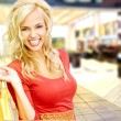 Shopping woman in mall - Stock Photo