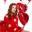 Beautiful girl with red balloons hearts — Stock Photo