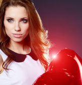 Valentines day woman holding red heart balloon — Stok fotoğraf