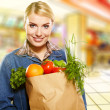 Woman buying some vegetables — Stock Photo