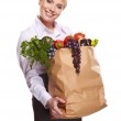 Beautiful young woman with vegetables and fruits in shopping bag — Stock Photo #19881619