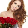 Beautiful female holding red roses bouquet, valentines day. — Stock Photo