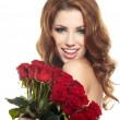 Beautiful female holding red roses bouquet, valentines day. — Stock Photo #19881809