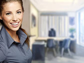 A portrait of a young business woman in an office — Stock Photo