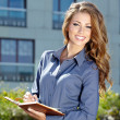Foto Stock: Young happy women or student on the property business background