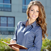 Young happy women or student on the property business background — Stock Photo