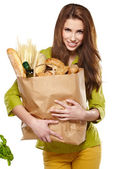 Girl holding a bag of food — Stock Photo