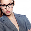 Attractive young business woman wearing glasses against white ba — Stock Photo #20795529