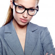 Stock Photo: Attractive young business woman wearing glasses against white ba