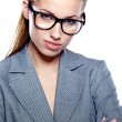 Attractive young business woman wearing glasses against white ba — Stock Photo
