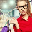 Beautiful shopping woman at a drawn mall — Stock Photo #20989559