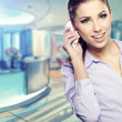 Modern business woman in the office with copy space — Stock Photo #20992273