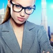 Portrait of cute young business woman outdoor over building back — Stock Photo #21049917