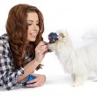 Caucasian young female lying on floor with her pet dog — Stock Photo #21050023