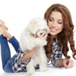 Caucasian young female lying on floor with her pet dog — Stock Photo #21050119