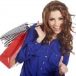 Woman standing with shopping paper bags and showing OK by hand. — Stock Photo