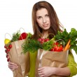Beautiful young woman with vegetables and fruits in shopping bag — Stock Photo