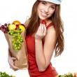 Stock Photo: Happy young woman with vegetables. Isolated over white.