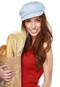 Young woman holding a grocery bag full of fresh and healthy food — Stock Photo