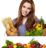 Young woman holding a grocery bag full of food. Vegetable border — Stock Photo