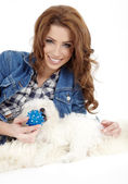 Playing with her dog — Stockfoto