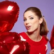 Woman with red heart balloon — Stock Photo #21120957