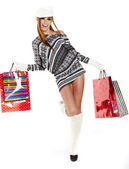 Winter woman with shopping bags over grey — Stock Photo