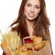 Smiling woman holding a grocery bag  — Stockfoto