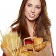 Smiling woman holding a grocery bag — Stock Photo #21342533