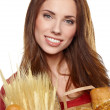 Smiling woman holding a grocery bag  — ストック写真