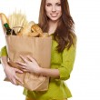 Girl holding a bag of food — Stock Photo #21492341