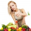 The young beautiful woman with the fresh vegetables — Stock Photo #21856595