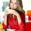 Beautiful young college student on a cafe. — Stock Photo #21859097