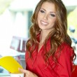 Beautiful young college student on a cafe. — Stock Photo #21859301