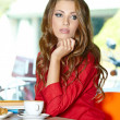 Beautiful young college student on a cafe. — Stock Photo #21859341