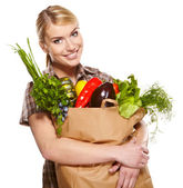 Young woman with a grocery shopping bag. Isolated on white backg — Stock Photo