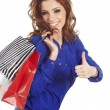 Woman standing with shopping paper bags and showing OK by hand. - Stok fotoraf