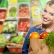 Woman grocery shopping at the local market — Stock Photo
