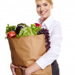 Young woman with a grocery shopping bag. Catering concept. — Stock Photo