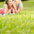 Portrait of two fitness woman having fun in summer environment — Stockfoto