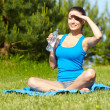 Outdoor workout woman. Fitness woman runner relaxing drinking wa — Stock Photo #22226805