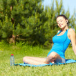Outdoor workout woman. Fitness woman runner relaxing drinking wa — Stock Photo #22226957