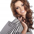 Portrait of young happy smiling woman with shopping bags, isolat — Stock Photo