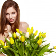 Pretty woman holding a bouquet of tulips — Stock Photo