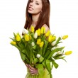 Pretty woman holding a bouquet of tulips — Stock Photo #22332623