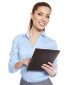 Young attractive business woman uses a mobile tablet computer wi — Stock Photo