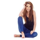 сексуальная девушка в синих джинсах — Стоковое фото