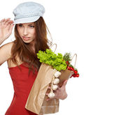 Portrait of happy young female holding a shopping bag full of gr — Stock Photo